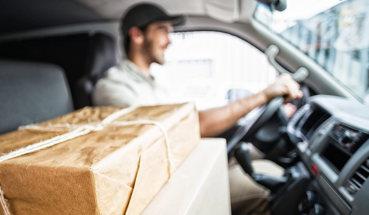 Man delivering package in truck