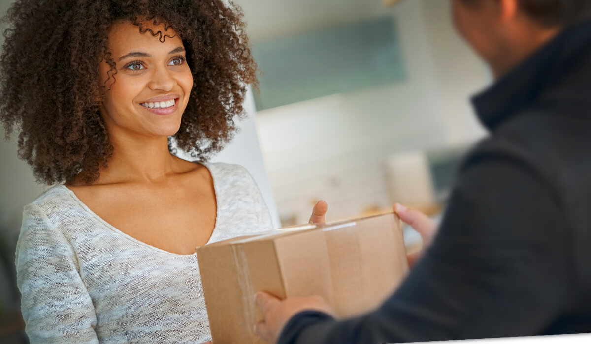Woman receiving delivered package