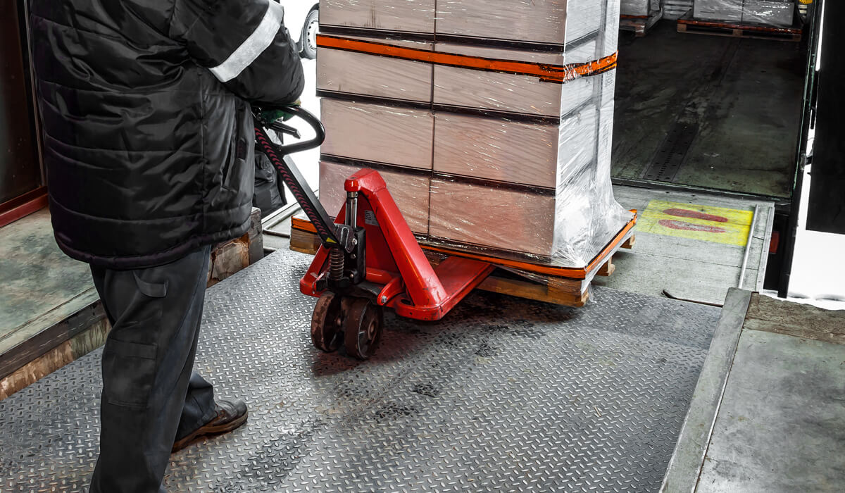 Man loading truck with palette jack